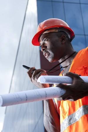 Construction worker speaking on Walkie-Talkie photo