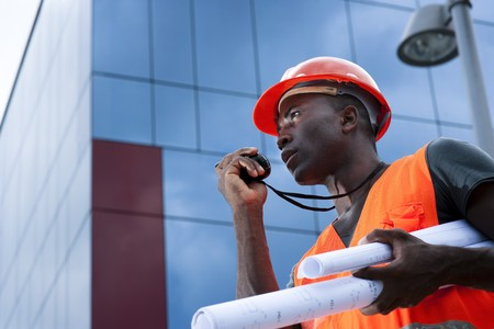 construction worker: Construction worker speaking on Walkie-Talkie