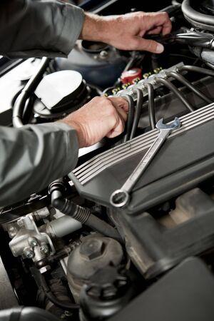 auto mechanic: Male hand repairing car engine