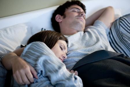 Relaxed couple sleeping photo
