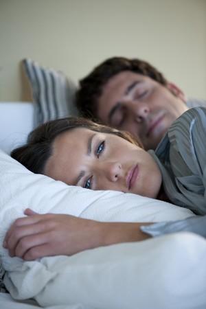 Young woman cannot sleep photo