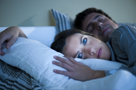 brown hair blue eyes: Young woman cannot sleep