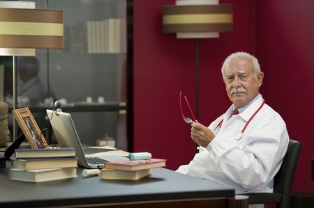 third age: Portrait of a senior doctor working in his studio Stock Photo