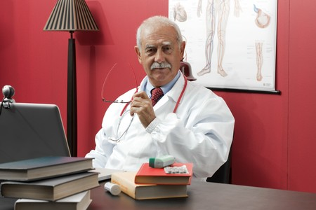 third age: Portrait of a confident senior doctor smiling at camera