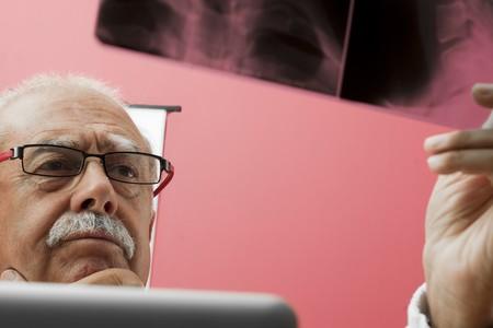 third age: Senior doctor examining x-ray Stock Photo