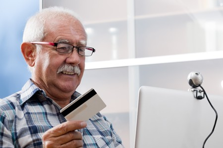 third age: Senior man doing online shopping Stock Photo