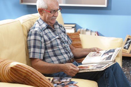 third age: Grandfather looking at his grandson pictures