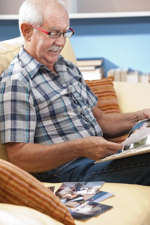 men 45 years: Grandfather looking at his grandson pictures