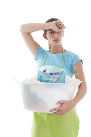 Tired Woman Doing the Laundry, white background Stock Photo - 8330474