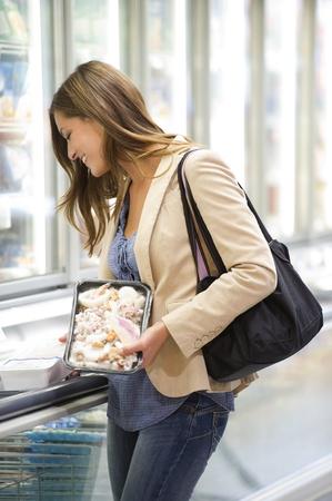 Young woman shopping at supermarket photo