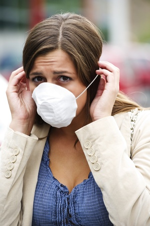 Young woman wearing breathing mask outdoors photo