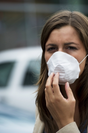 pollution: Young woman wearing breathing mask outdoors