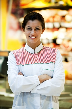 Portrait of a smiling supermarket employee photo