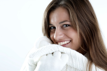 sof: Portrait of a young woman in sof white sweater Stock Photo