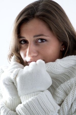 Portrait of a young woman in sof white sweater photo