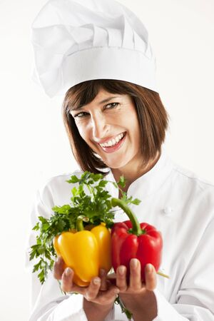 Cheerful Female Chef With Vegetables photo