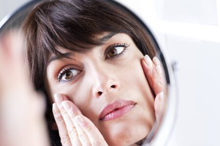 Woman Looking At Herself In The Mirror Stock Photo - 8678031