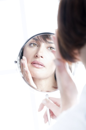 mature women only: Woman Looking At Herself In The Mirror