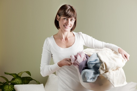 Woman carrying laundry basket Stock Photo - 8678025