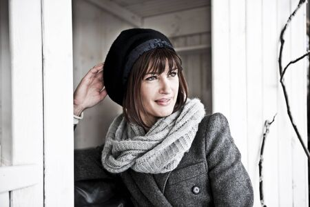 Beautiful Woman In Winter Clothes, Desaturated Image photo