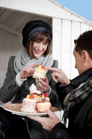 Couple Enjoying Pastry Outdoors Stock Photo - 8677910