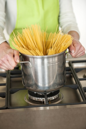 peron: Woman Preparing Spaghetti In Pot, close-up