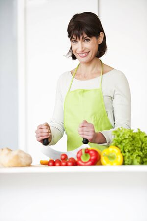 Happy Woman Preparing Meal photo