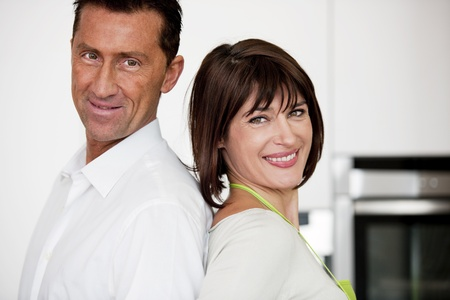 Happy Couple In The Kitchen, Smiling at camera