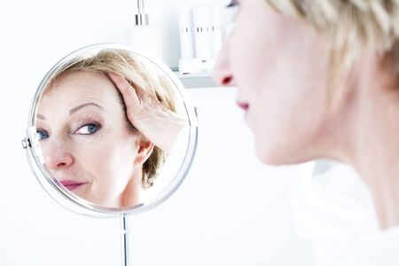 reflection in mirror: Woman In The Mirror
