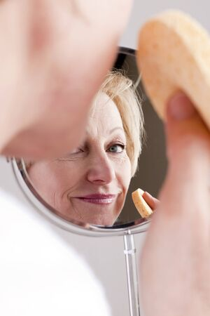 Mature Woman Cleaning Face photo