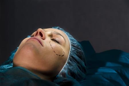 plastic surgeon: Woman receiving Plastic Operation