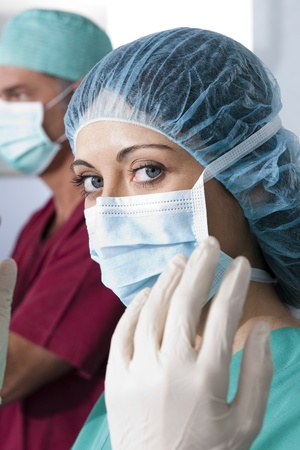 Portrait of a female surgeon, operation in the background photo
