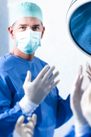 Portrait of a male surgeon at work photo