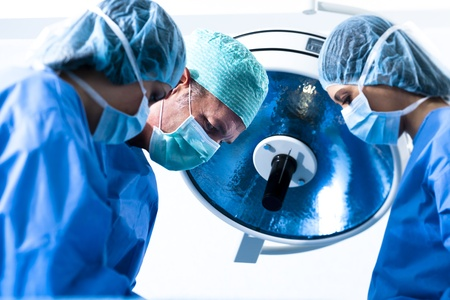 Portrait of team of surgeons at work photo