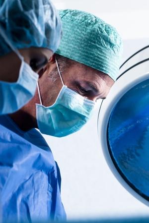 Two surgeons operating, close-up photo