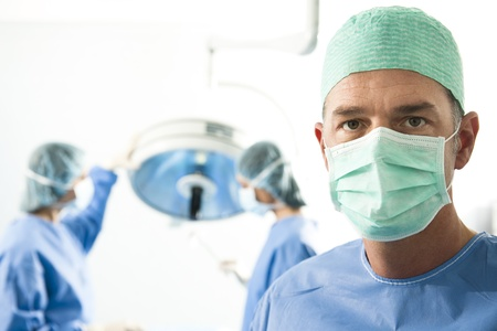 Portrait of team of surgeons at work Stock Photo - 8943613