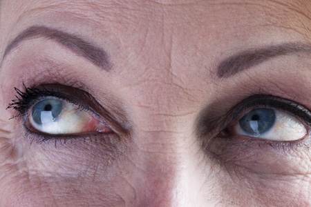 Close-up of a mature woman eyes photo