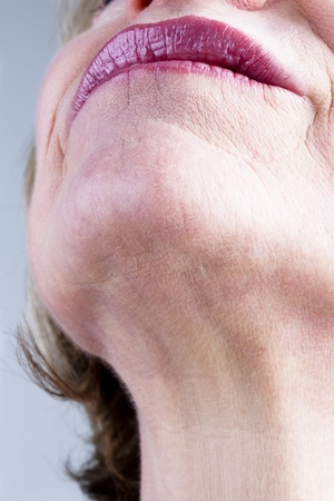 wrinkles: Close-up of mature woman neck Stock Photo