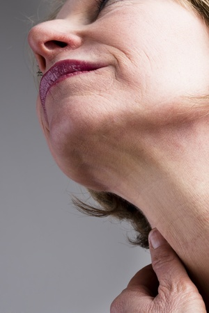 one mature woman only: Close-up of mature woman neck Stock Photo