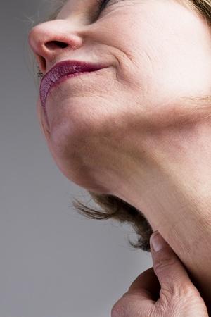 human neck: Close-up of mature woman neck Stock Photo