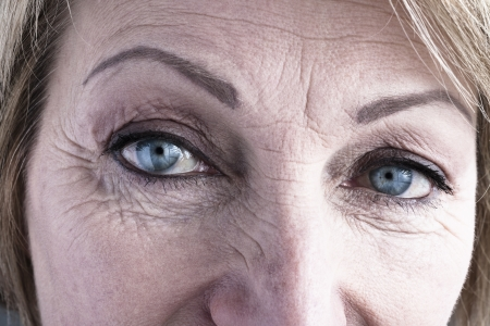 wrinkles: Close-up of mature woman blue eyes