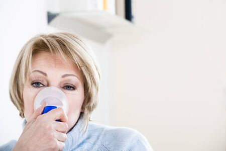 Woman Using A Nebulizer for respiratory treatment Stock Photo - 9051918