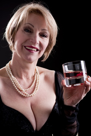 mature women only: Happy Mature Woman With Drink