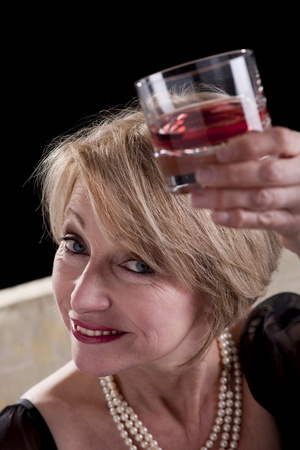 Happy Mature Woman With Drink photo