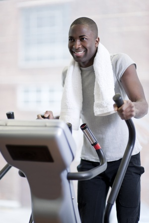 health club: Attractive man at health club, exercising on stepper Stock Photo