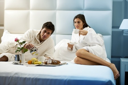 breakfast hotel: Relaxed Couple in Bed, hotel room