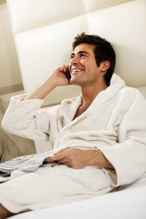 domestic room: Relaxed Man in Bed, hotel or domestic room Stock Photo