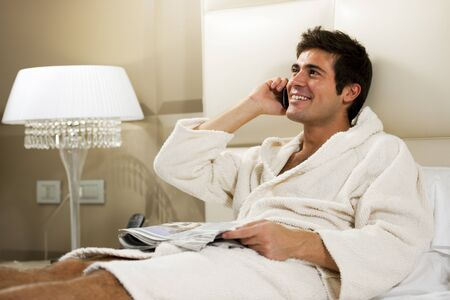 Relaxed Man in Bed, hotel or domestic room Stock Photo - 9260315