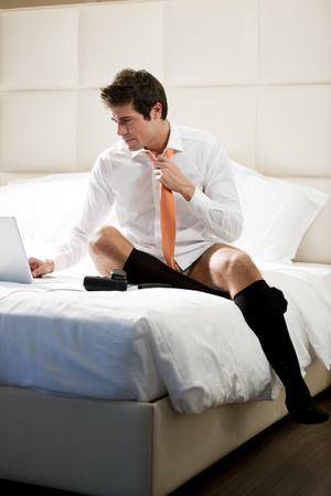 Relaxed Businessman Working in Hotel Room Stock Photo - 9260323