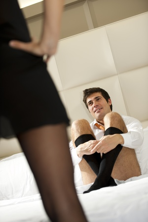 Woman tempting her man wearing sexy lingerie photo